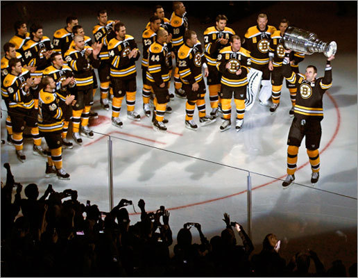 Captain Zdeno Chara held the Stanley Cup as Bruins players skated onto the ice before the start of the ceremonies.