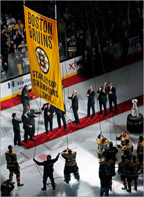 The defending-champion Bruins opened their 2011-2012 season vs. the Philadelphia Flyers Thursday night. Before the game, the Stanley Cup banner from the 2010-11 season was raised to the rafters.