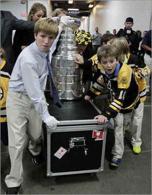 Children helped escort the Stanley Cup through the inner halls of TD Garden.