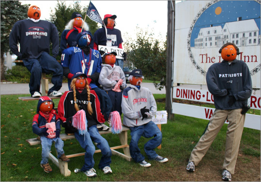 Pumpkin Patriots fans cheered on a likeness of Bill Belichick - complete with hoodie - at the 1785 Inn.