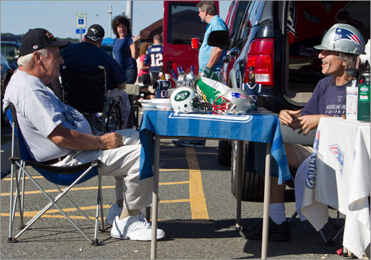 Michael Alberta Sr. of Milford enjoyed a pregame meal with his son, Michael Alberta of Whitinsville in the parking lot before the game.