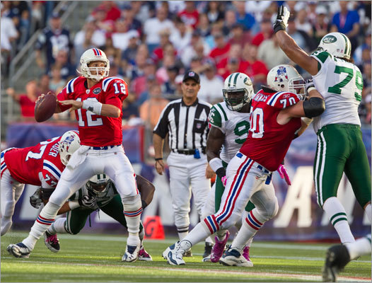 Patriots quarterback Tom Brady completed a pass to tight end Aaron Hernandez (not pictured) in the first quarter.