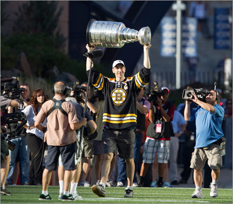 Bruins captain Zdeno Chara carried the Stanley Cup onto the field before the Patriots-Jets game on Oct. 9. The 2010-11 Bruins won the franchise's sixth Cup title in June, beating the Canucks four games to three.