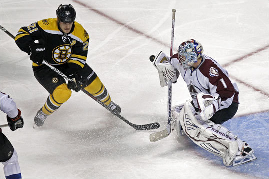 Avalanche goalie Semyon Varlamov made a third-period blocker save with the Bruins' Andrew Ference sitting on his doorstep.