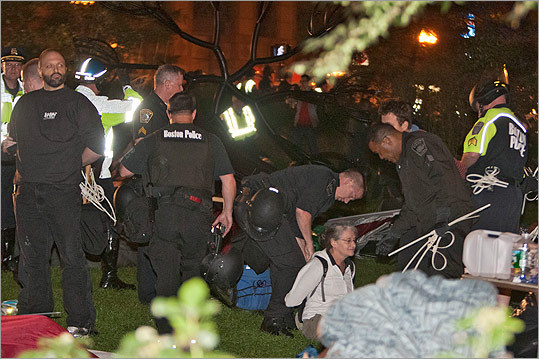 Police restrained a protester on the Greenway.