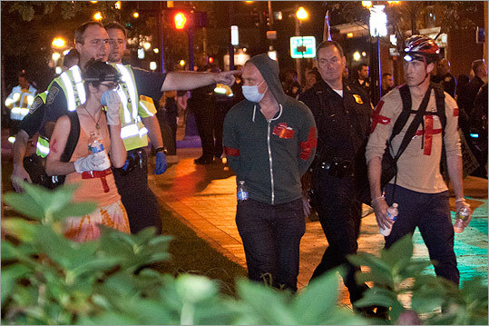 Boston Police warned medical helpers to leave or face arrest.