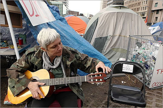 Lisa Giuliano, 52, of New York City, tuned her guitar as she and other protesters set up tents.