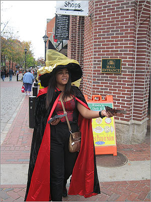 Dorcas Mena handed out pamphlets for Omen Physic Parlor and Witchcraft Emporium.
