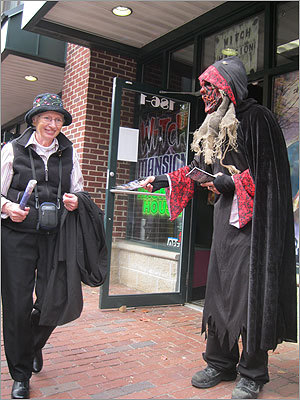 Chris Lonergan passes out pamphlets outside the Witches Mansion haunted attraction in Downtown Salem.