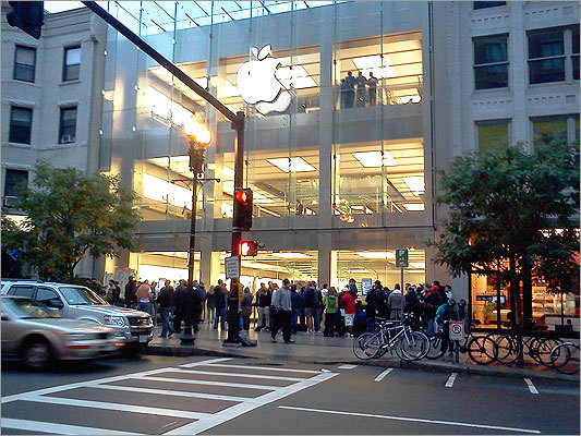 Apple fans began lining up outside Boston's Boylston Street Apple store as early as 6 p.m. the day before the iPhone's release in October. Here are scenes from across the world of people looking to buy Apple's latest product.