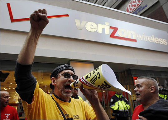 On Thursday, protesters shouted out slogans outside the Verizon store.