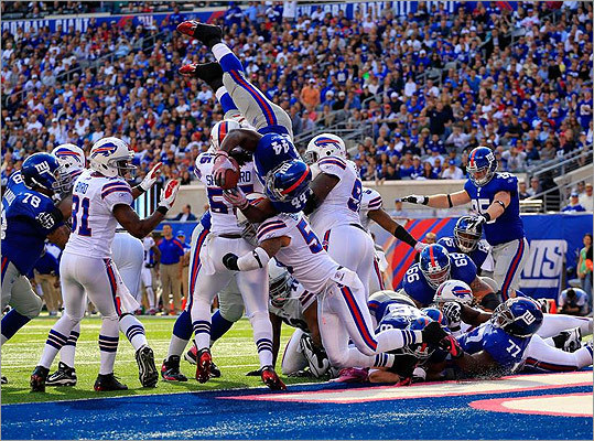 Giants 27, Bills 24 Bradshaw's 3 TDs lead Giants over Bills For a change, the New York Giants didn't have to rely solely on Eli Manning's arm. They are heading into the bye week with hope, now that they've found a running game. Recap | Box score