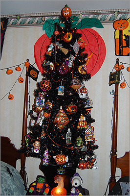 """Of the claims that the hotel is haunted, Lederhaus said, """"There's no documentation. People tell us they feel things, whatever, but we don't have any documentation.' Left: A Christmas tree decorated with Halloween ornaments dresses up a guest room."""