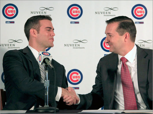 Former Red Sox general manager Theo Epstein (left) shook hands with Cubs owner Tom Ricketts after Epstein was introduced as the new president for baseball operations for the Cubs during a news conference in Chicago on Tuesday.