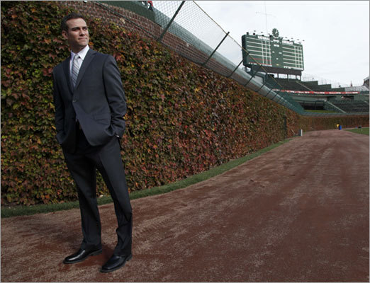 Epstein posed in front of Wrigley Field's famous ivy-covered outfield wall following his introduction as president of the Cubs' baseball operations.