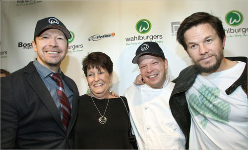 The Wahlberg brothers and their mother, Alma, turned out at the Hingham Shipyard for the opening of Wahlburgers, a 'casual food' eatery next to their upscale Alma Nove. Shown here are (from left) Donnie, Alma, Paul, and Mark Wahlberg.