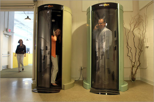 Partners + Simons has cellphone booths When employees at Partners + Simons ad agency in South Boston need some privacy for a phone call, they don't have to leave the office. Instead, they slip inside one of two large, tube-like, soundproof booths in the company's coffee and kitchen area where they can chat away. The agency has two cellphone booths that look like something straight out of the transporter room from Star Trek. Read more Left: Partners + Simons' chief executive's assistant Margaux Stunzi, left, and Tony Cotrupi, president of the company, in the cellphone booths.