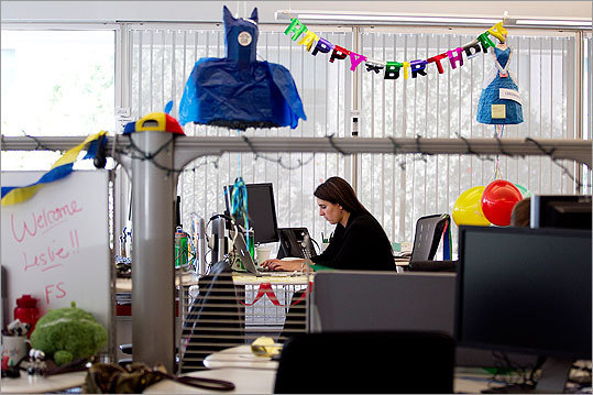 Amanda Del Balso, an account manager, worked on her birthday, surrounded by birthday decorations that her co-workers had placed around her desk.