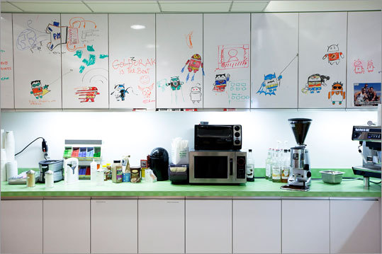 One of the kitchen areas has drawings on the eraser board surfaces of the cabinets.