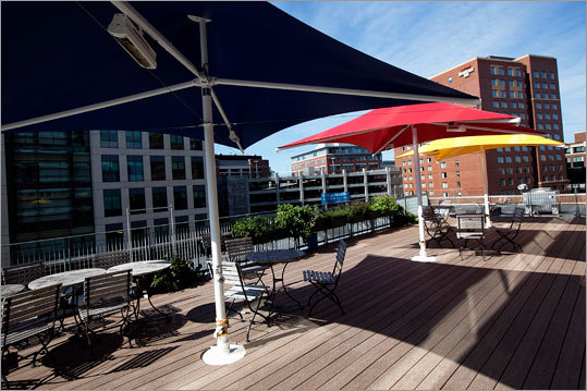 The outdoor patio is heated and has three colorful umbrellas, as well as a small garden open to employee use.