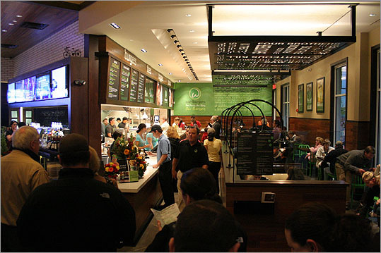 Two days after the Grand Opening in November, Wahlburgers in the Hingham Shipyard was crowded with people, the smell of hotdogs and hamburgers wafting through the air.