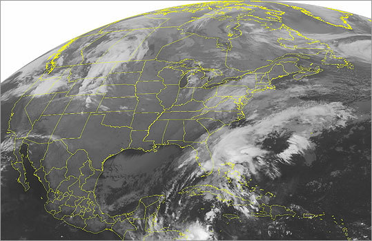 This NOAA satellite image taken Saturday at 5:15 a.m. shows clouds moving into the Northeast associated with a strong storm that will bring record breaking snow. In this image, it is snowing in the Appalachians.