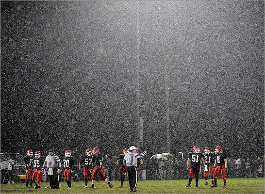Communities inland are expected to get hit hardest; Cherry Grove, W.Va., on the edge of the Monongahela National Forest, already got 4 inches of snow overnight, according to the National Weather Service. Pictured, snow blankets the field during the first quarter of a high school football game on Oct. 28 in Staunton, Va.