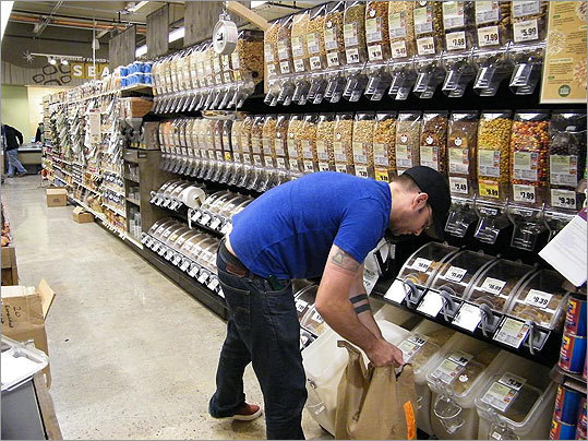 "Customers can choose from a large selection of nuts, grains, and seeds in the ""bulk section."""