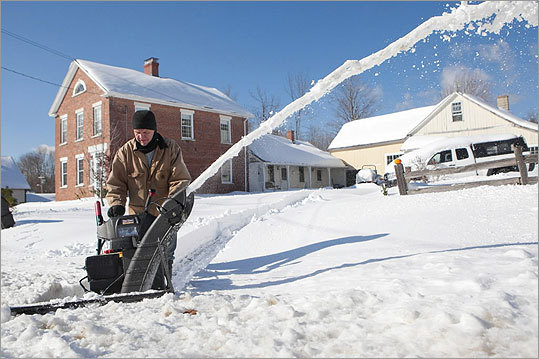 Many residents, such as Larry Preston, of Plainfield, dusted off their snow blowers to use after the weekend's storm.