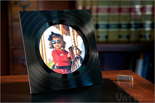 Recycled Vinyl Record Picture Frame Price: $17.99 This recycled record frame is the perfect gift for the lover of all-things vintage or that friend who goes out the way to recycle.
