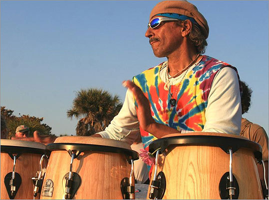 As the Sunday sun lowered over the Gulf, Siesta Key's drumming circle heated up, drawing actors, dancers, revelers and a cast of Sarasota characters.