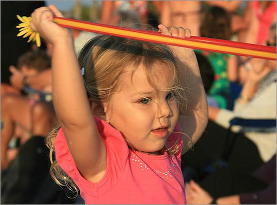Sarasota's passions are of the Old Florida kind, like its love affair with the hoola hoop for fitness and fun. Shown, a young girl tried their skill on Siesta Key.