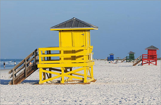 Siesta Key's colorful wooden lifeguard towers are not only iconic, they also have code names according to a local newspaper. Red is the 'meet and greet' tower where young people hang out. Green is 'the family-oriented tower' because families with kids tend to gather there. Yellow, shown, is 'the U.N. tower' because it draws a diverse crowd. And blue is 'the geriatric tower' for, well, obvious reasons.