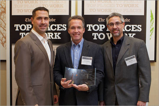 From left: Scott Waugh, Carl Gustafson, and Dan Kline of Sports and Physical Therapy Association, ranked No. 15 for small employers.