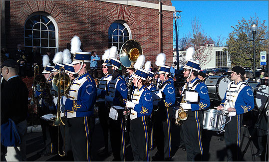 Members of Needham High School's marching band performed the National Anthem and other patriotic tunes throughout the ceremony.
