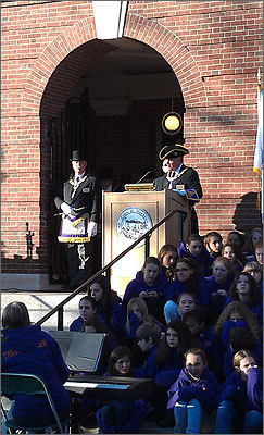Masons are seen here performing the re-dedication of the cornerstone. The middle school chorus group 'TrebleMakers,' seen to the right, later performed 'Circled by a Circling River,' an original work celebrating Needham's 300 years by world-renowned children's composer Nick Page.