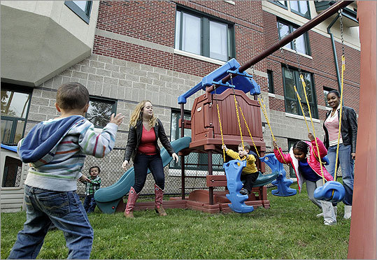 """We know the statistics are pretty grim as far as single parents getting out of the poverty level,'' said Siergiewicz. ""This program gives them a future.'' She said the children also benefit from being together and having access to quality day care. Students and mothers have some fun at the playground that is behind the dormitory building where they live."