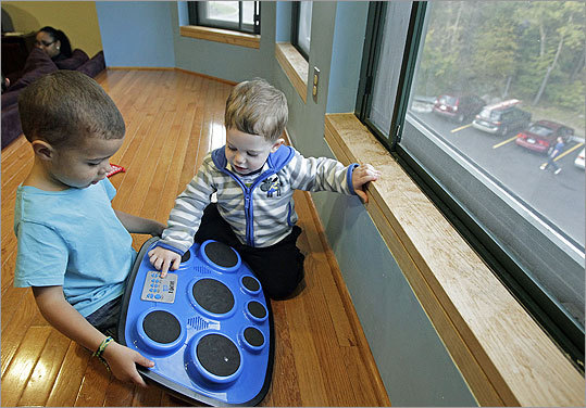 Amanda Lapierre, 21, and Meghann Martino, 22, are good friends and college roommates. But that's not all; they're both single parents of toddlers. Pictured: Amanda Lapierre's son Zavier (left) and Meghann Martino's son Jackson (right) play together in the third floor dorm room.
