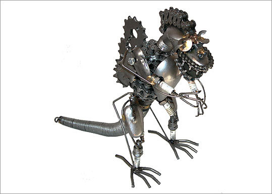 Metal Dinosaur Figurine - 12 inch Price: $59.99 One of the quickest ways to have a unique work space is to add a 12-inch metal dinosaur. It's a conversation starter and just awesome.