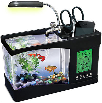 USB Fishquarium Price: $39.99 This is a working fish tank, pen holder, clock, and calendar. Think how much better of a cube you'd be giving the gift recipient with just this one item.