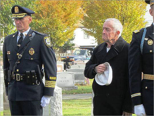 Faces at the cemetery: Wakefield Police Chief Rick Smith and Melrose resident and retired Navy man Jim Day.