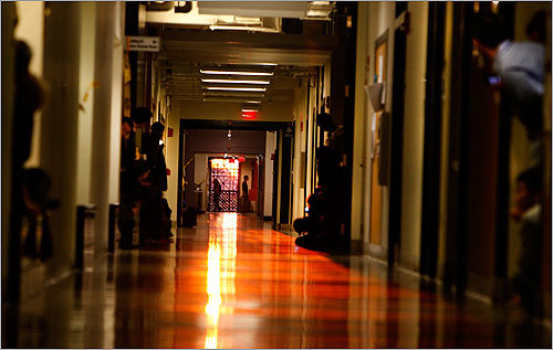 ... and reflected along the corridor's polished floor.