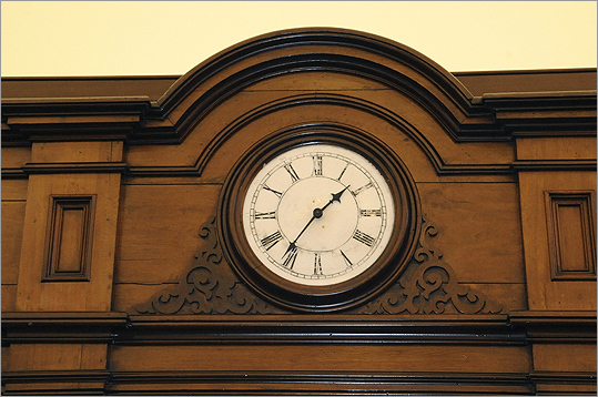 Superior court is slated to open for business on Nov. 21 while the other three courts should all be operational before Christmas, according to Richard L'Heureux , manager of programing, planning and design for the Trial Court of Massachusetts. Pictured: Clock in the law library of the J. Michael Ruane Judicial Center.