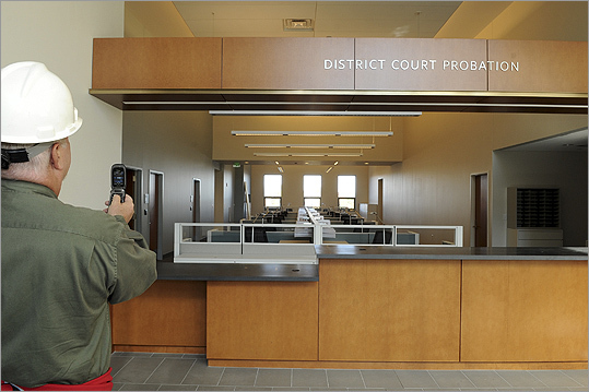 Pictured: Jean Pelletier, Salem, MA Ward 3 Councillor, takes a photograph of the District Court Probation desk while on a tour.