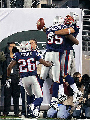 Ninkovich leaped into the arms of defensive end Mark Anderson as cornerback Phillip Adams looked on.