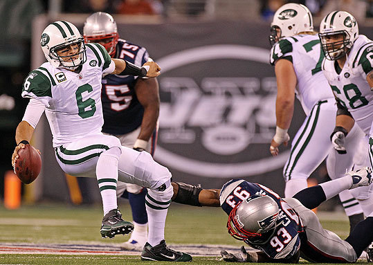 Andre Carter set a Patriots record with 4 1/2 sacks, including this one-handed one of Mark Sanchez in the third quarter.