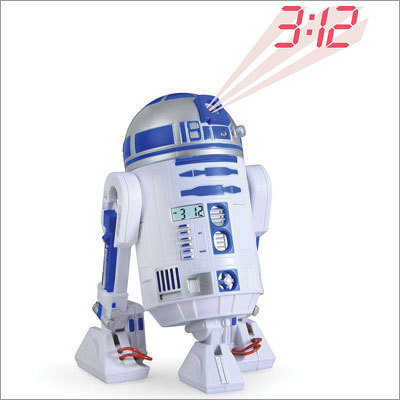 The R2-D2 projection alarm clock Price: $39.95 Why allow your friends to wake up to an annoying, buzzing alarm clock? This R2-D2 look-alike will wake you up by beaming the time and making his trademark chirping sounds.