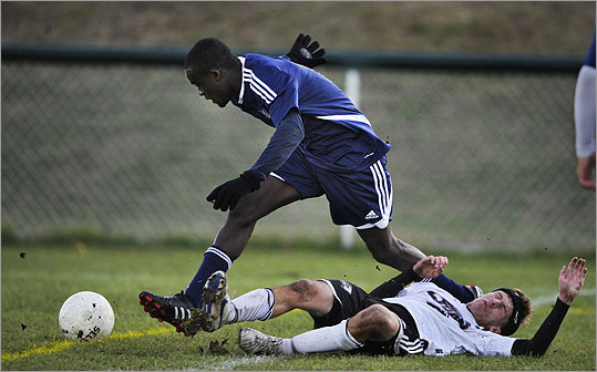 With hustle and heart, the Mustangs fought for every ball. It was a season of growing up for the team of 19 teenage boys whose families come from nine foreign countries. Medford's Jean Joseph heads for the ball over a downed Chelmsford player.