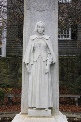 The Mother Pilgrim statue was erected in 1921 as part of the tercentenary celebration. It stands on the waterfront near Plymouth Rock. Behind the woman's likeness are listed the names of the women who arrived on the Mayflower.