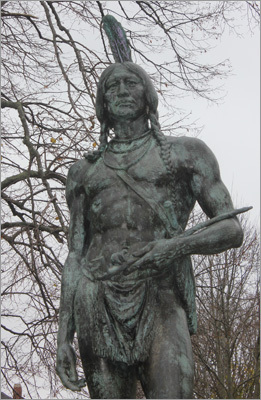 The statue of Massasoit stands stoically atop a hill facing the waterfront. It was erected in 1921, during the Pilgrim tercentenary. Massasoit, which means 'Great Chief,' was a legendary friend to Pilgrims, and a major source of long-lasting peace with the colonists, though he steadfastly did not allow any of his tribe to convert to the Pilgrims' Christianity.